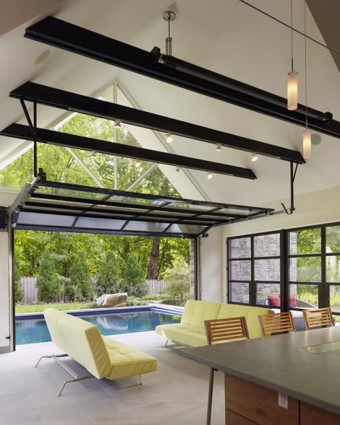 Glass Garage Door by the Swimming Pool