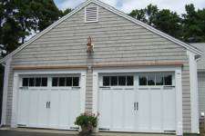 Garage doors with decorative hardware